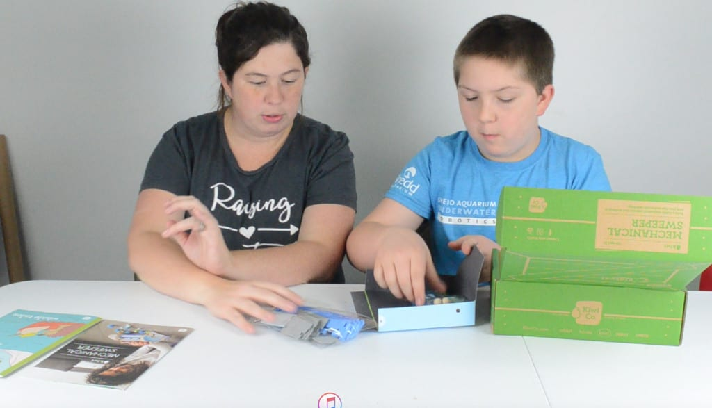 mother and son unboxing STEM subscription box