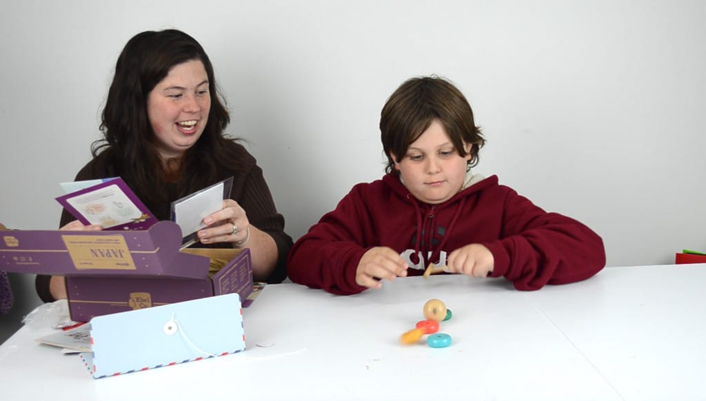 mother and son unboxing Japan kids subscription box