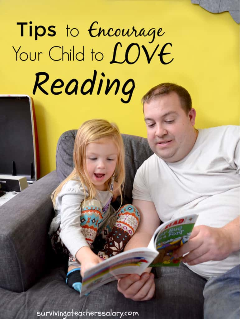 preschool girl reading with father