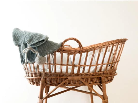 wicker baby crib stock photo