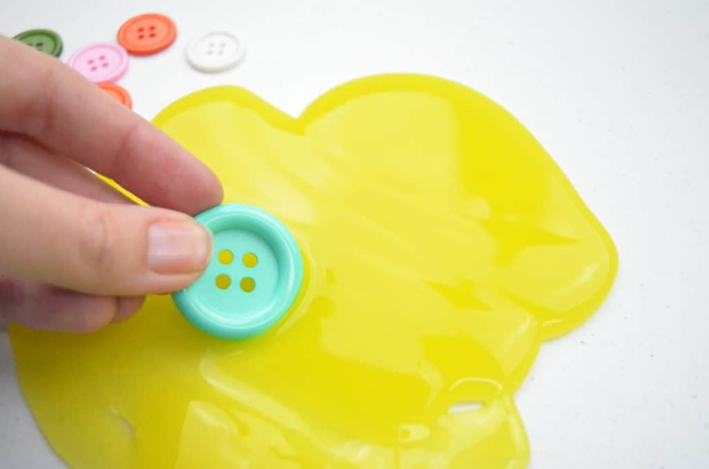green button and yellow slime