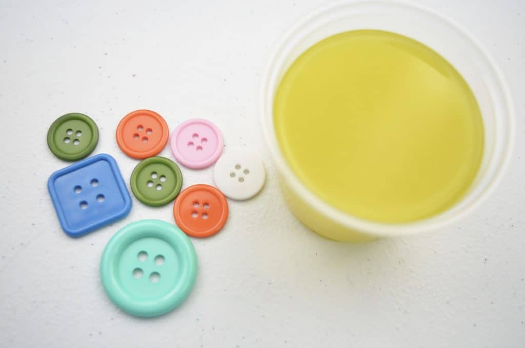buttons and cup of yellow slime