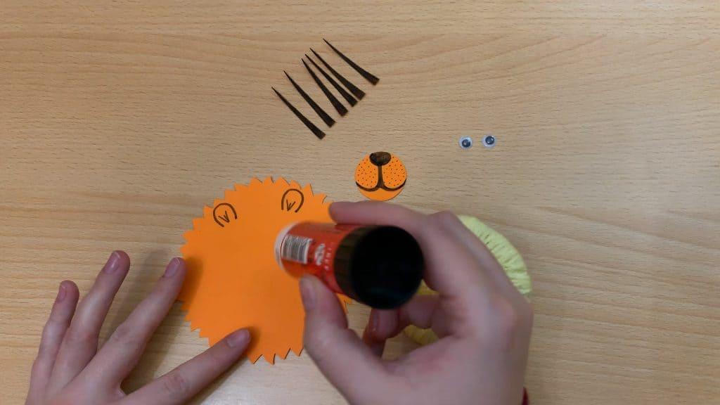 glueing nose on lion craft