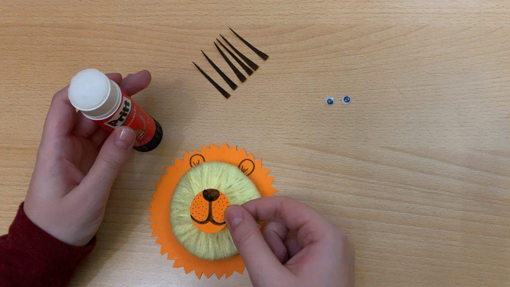adding nose on lion craft