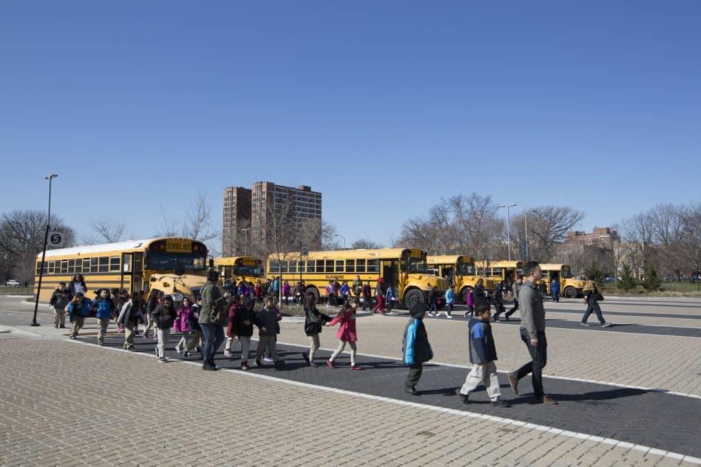 school children in front of school bus