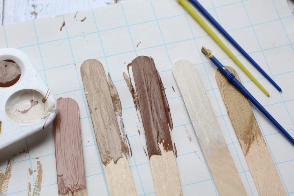 painting multicultural skin craft sticks