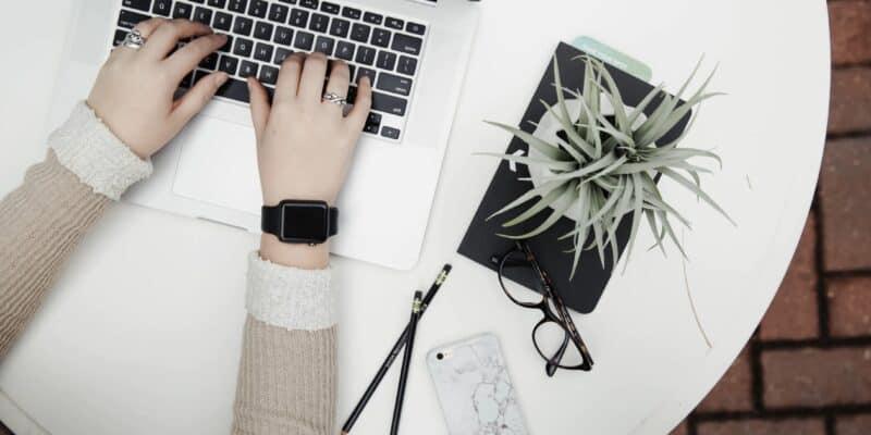stock hands typing computer