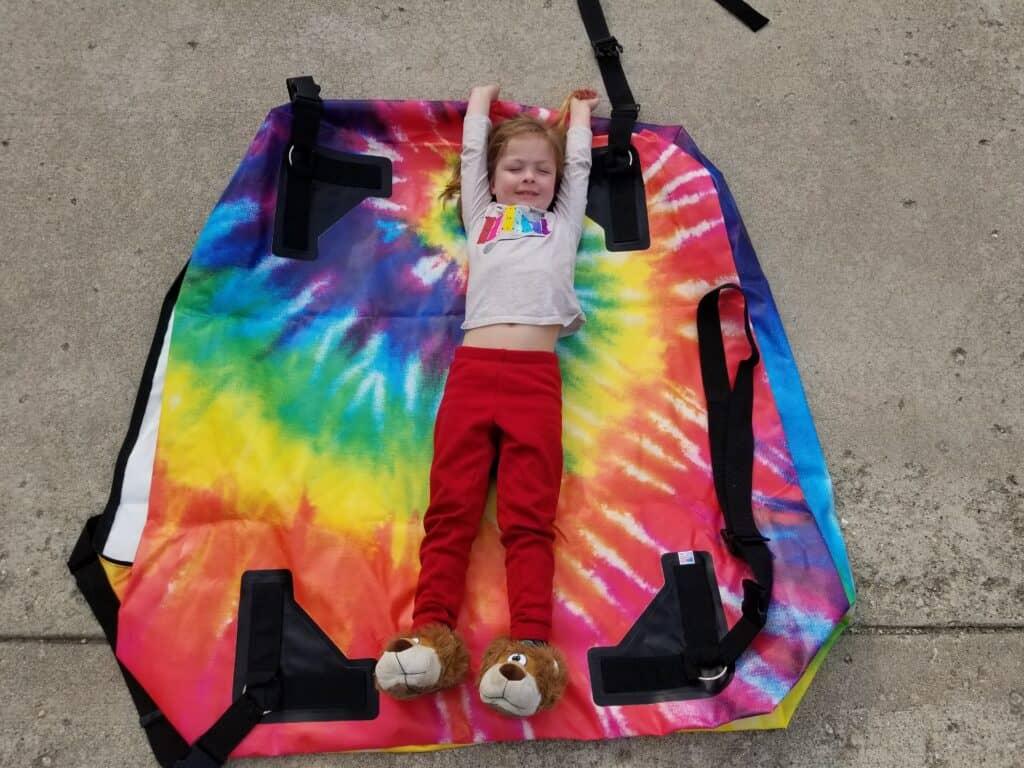 little girl on tie dye background