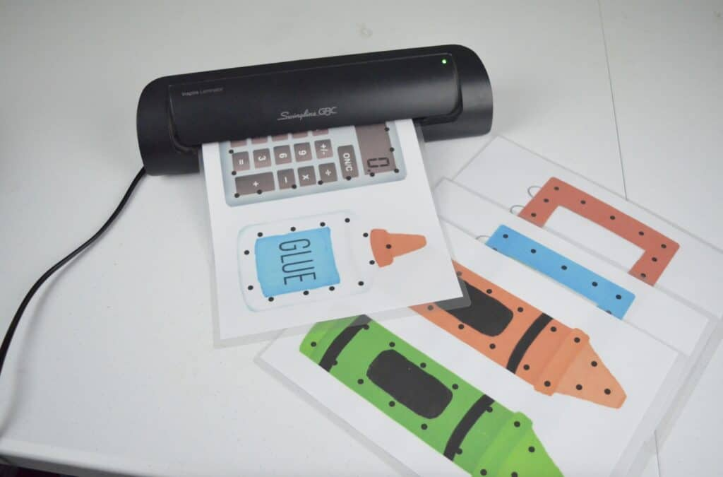 laminating school supply lacing cards activity