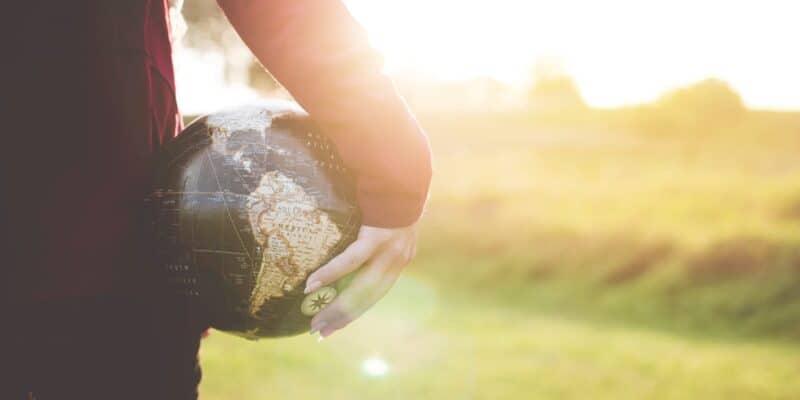 holding globe stock