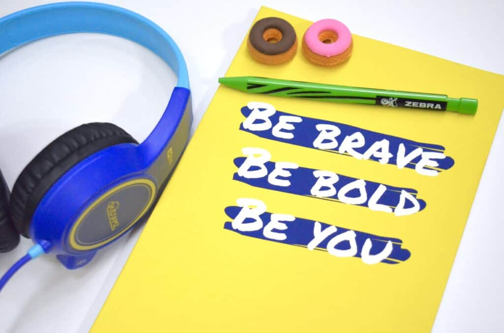 yellow inspirational notebook with headphones
