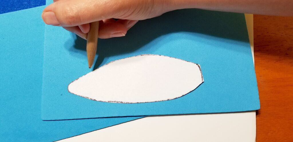 tracing white bunny ear on blue craft foam