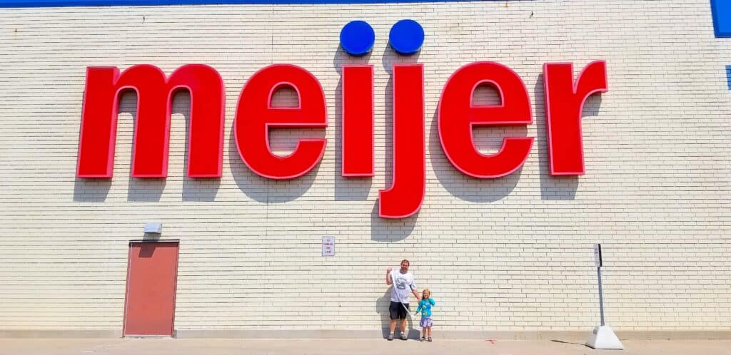 father daughter in front of meijer store