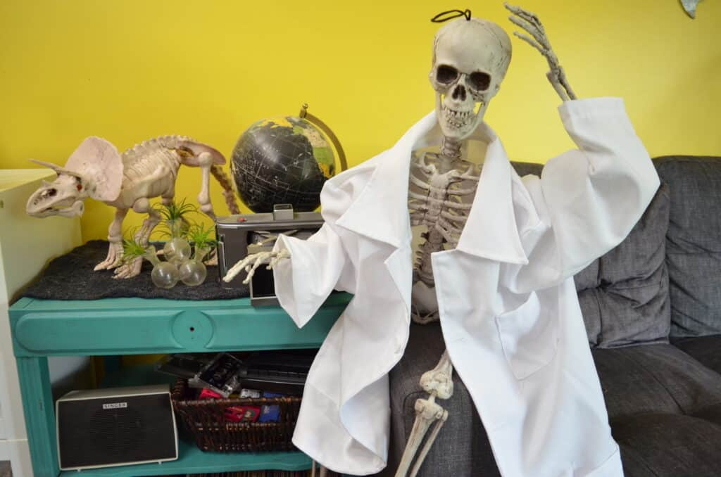 skeleton wearing lab coat