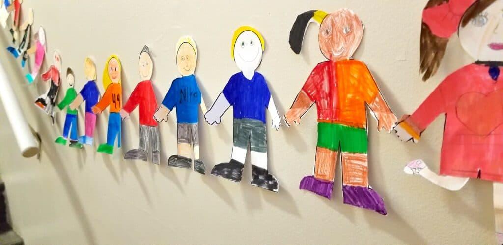 paper children holding hands kindness stock