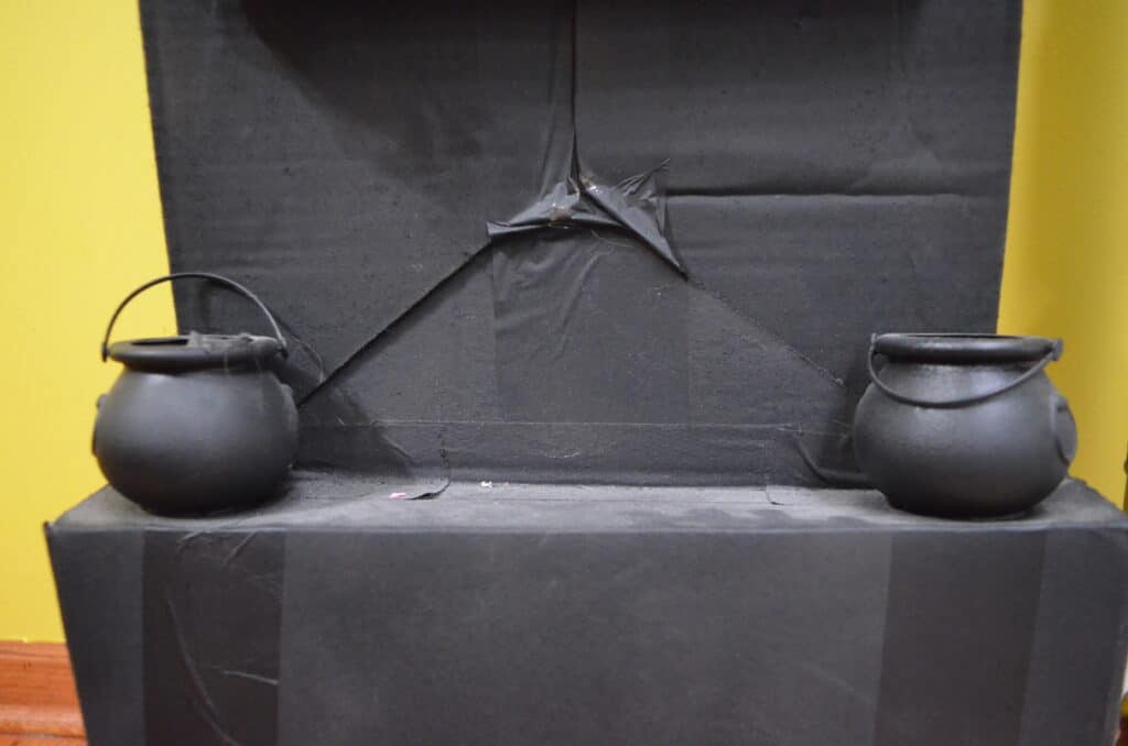 black cauldrons on halloween clock