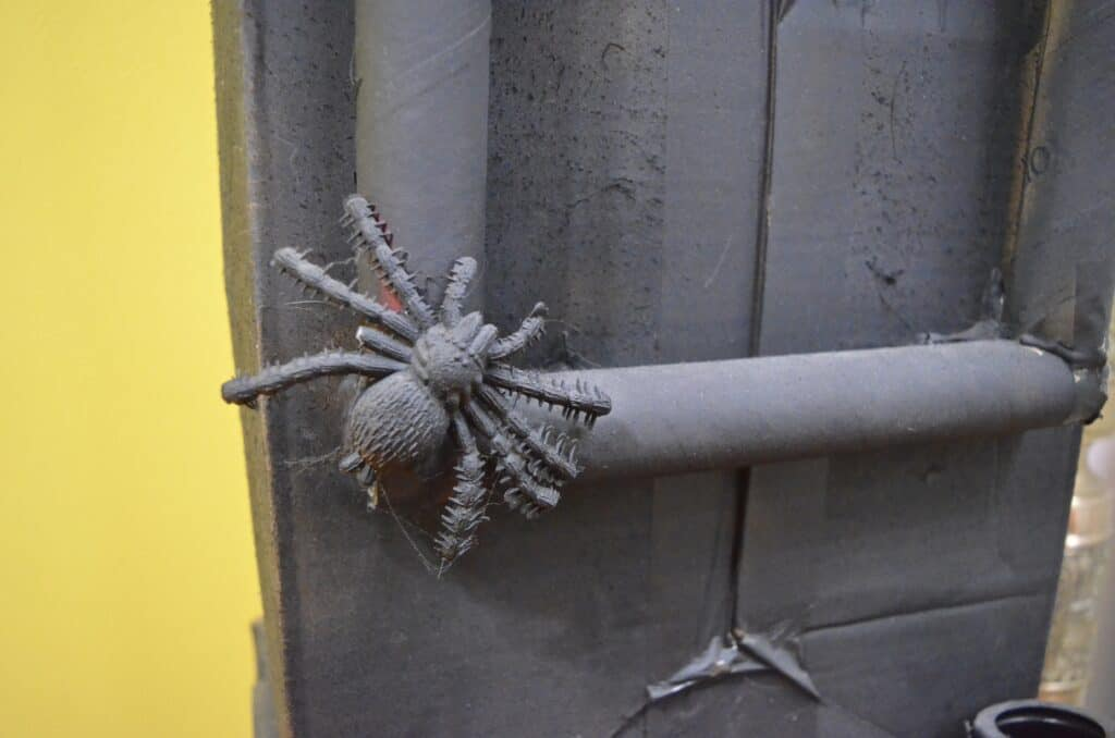 black halloween spider on clock