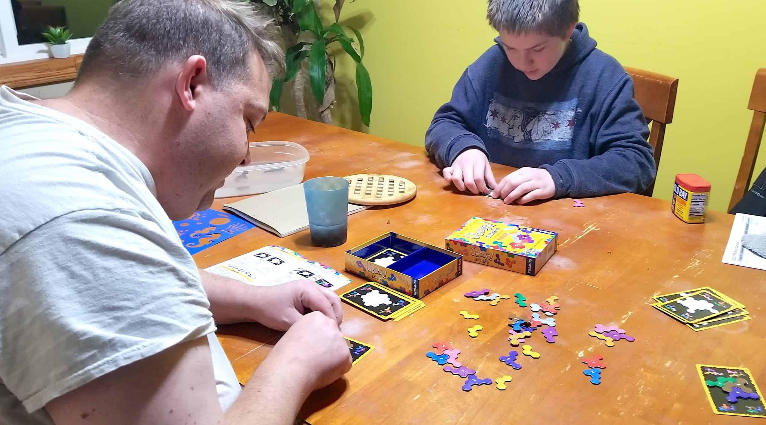 dad and teen playing math game Ubongo Extreme
