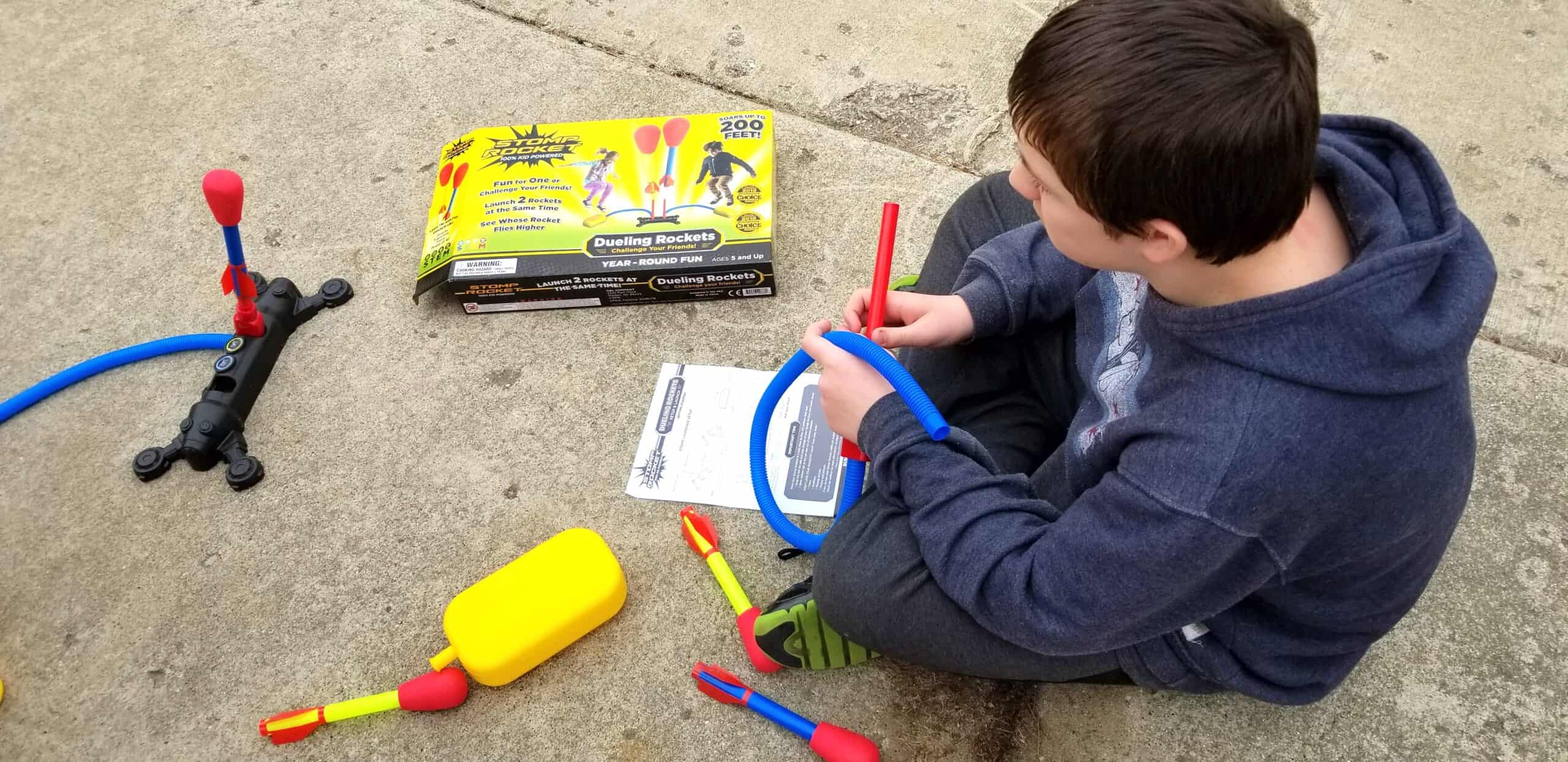 boy putting together stomp rockets kit