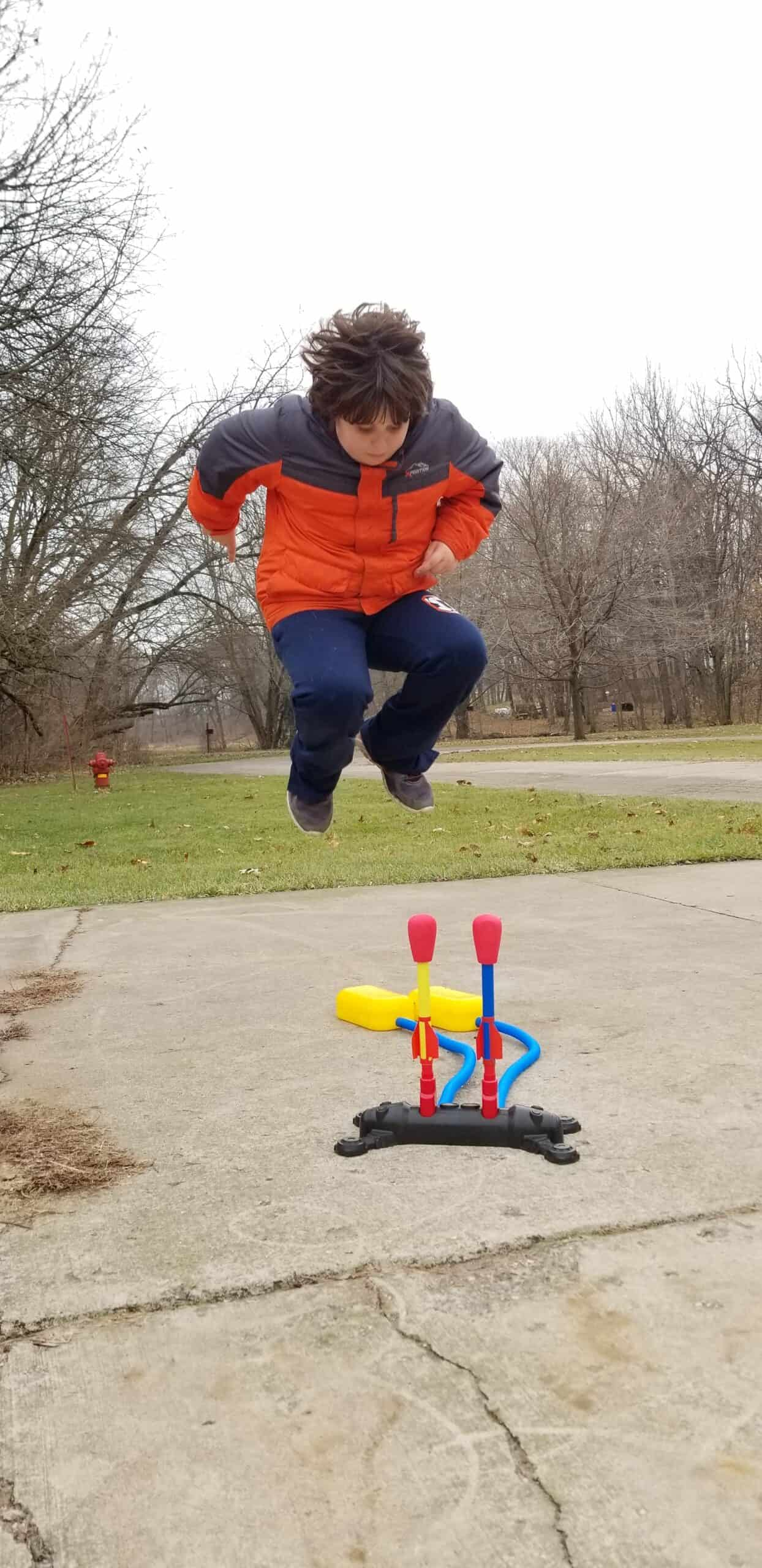 boy jumping on stomp rockets toy