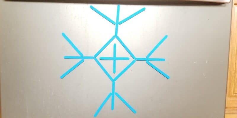 Symmetrical Snowflake Craft Stick Magnetic Activity + Printables