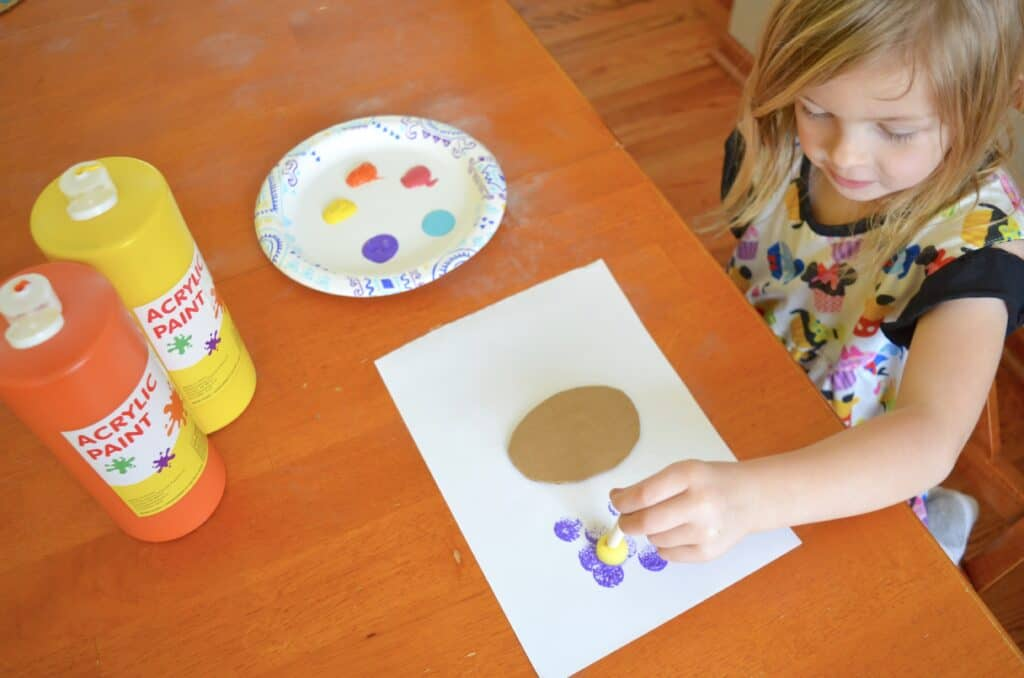 child painting with sponge