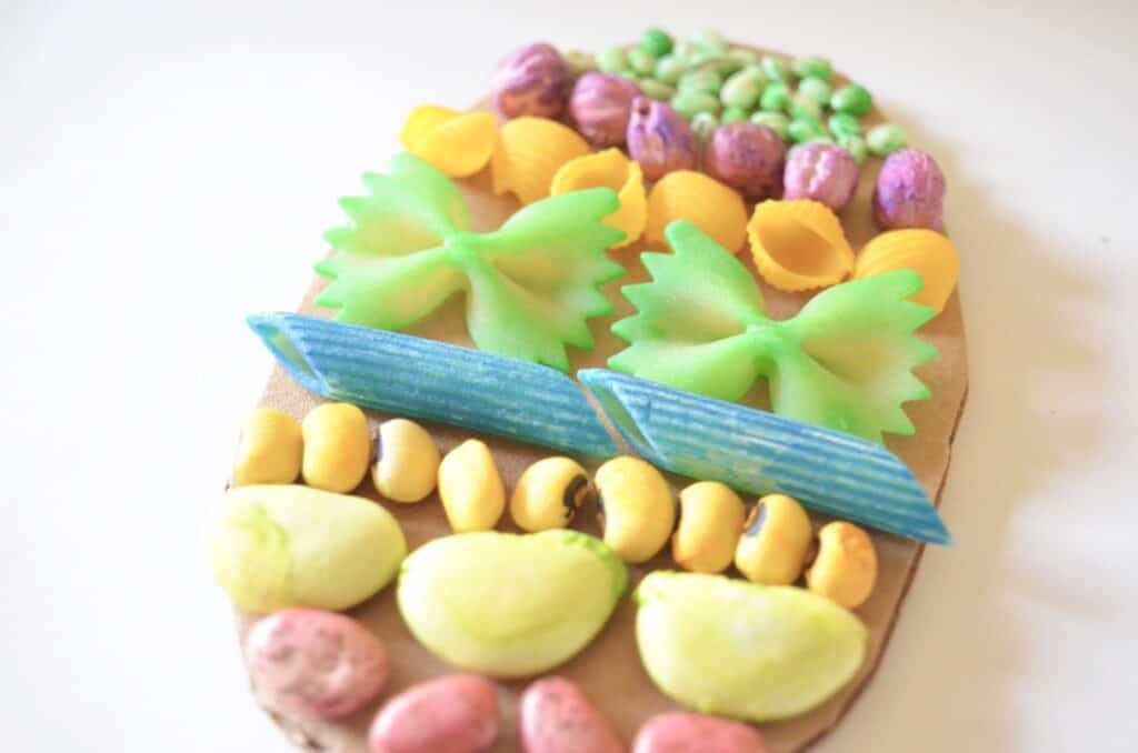 pasta noodles and beans on easter egg craft