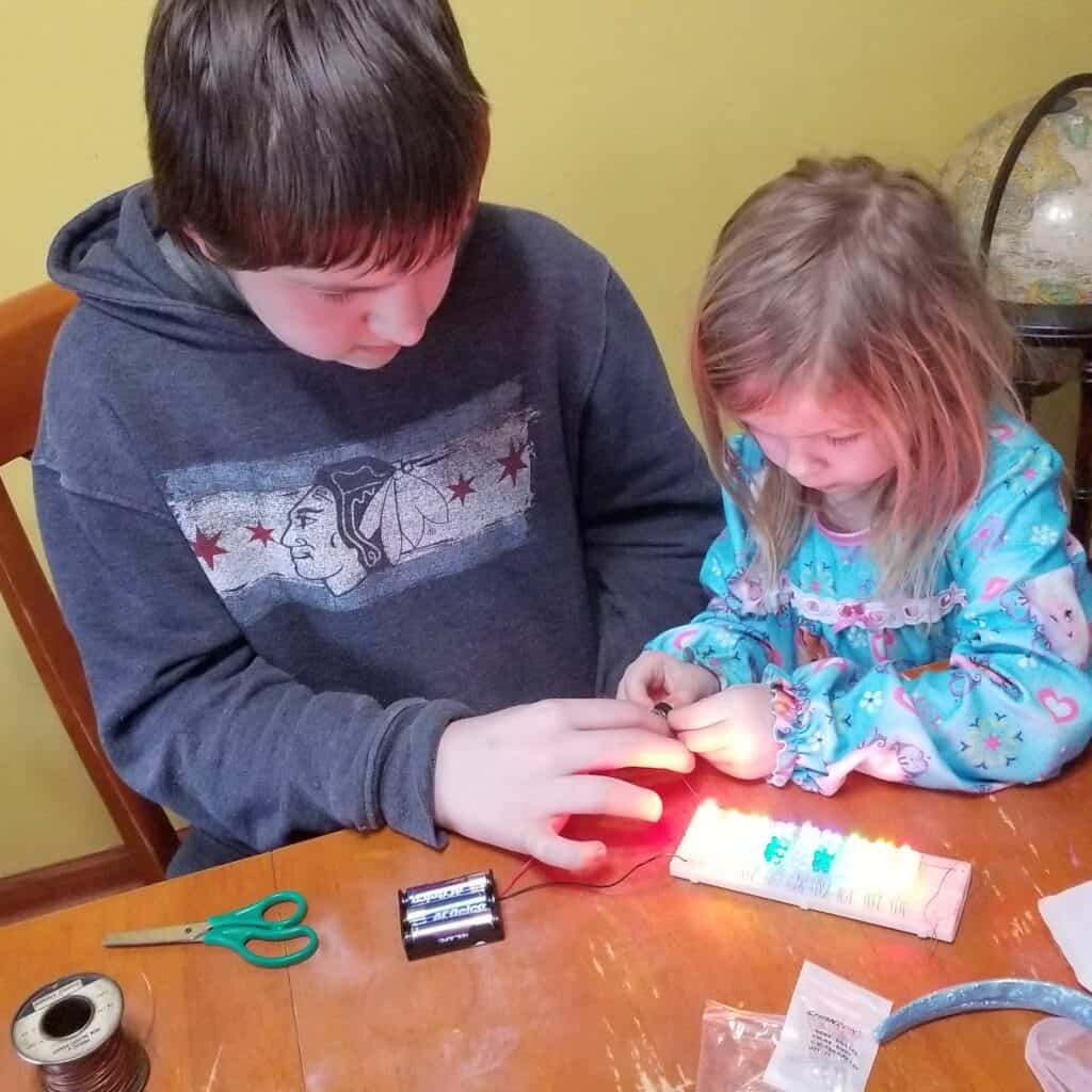 teen boy and preschool girl science experiment