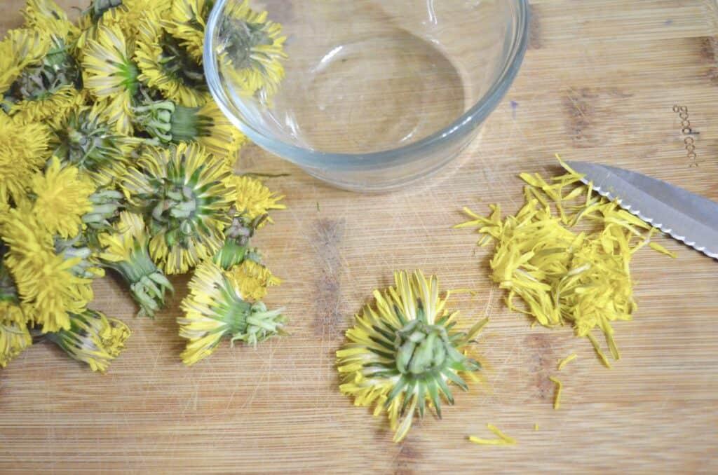 cutting dandelion flower petals