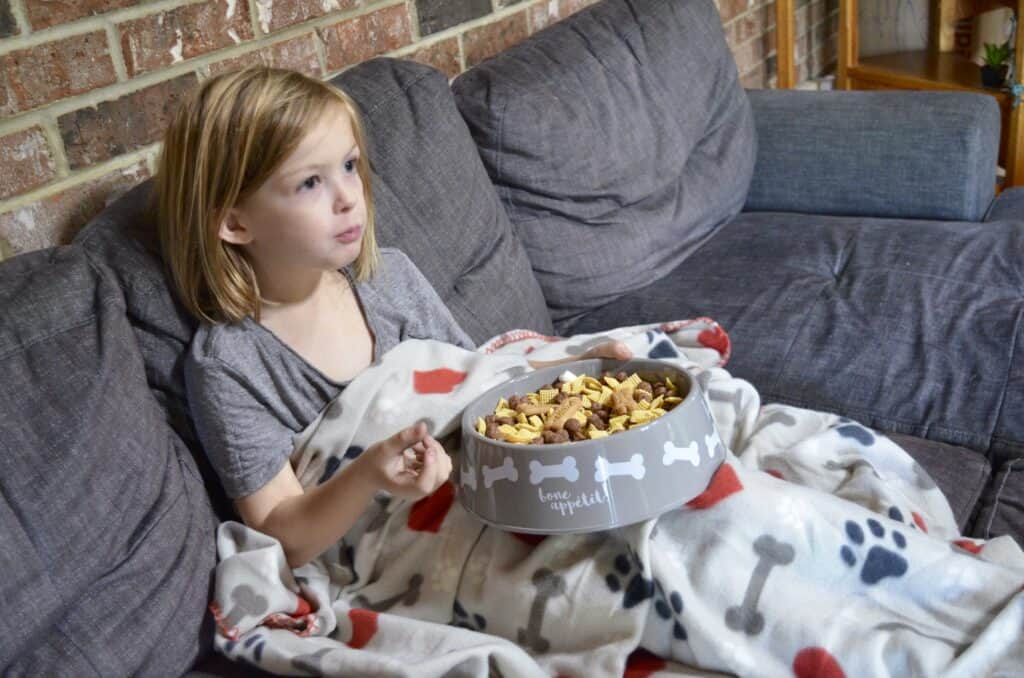 little girl eating puppy chow