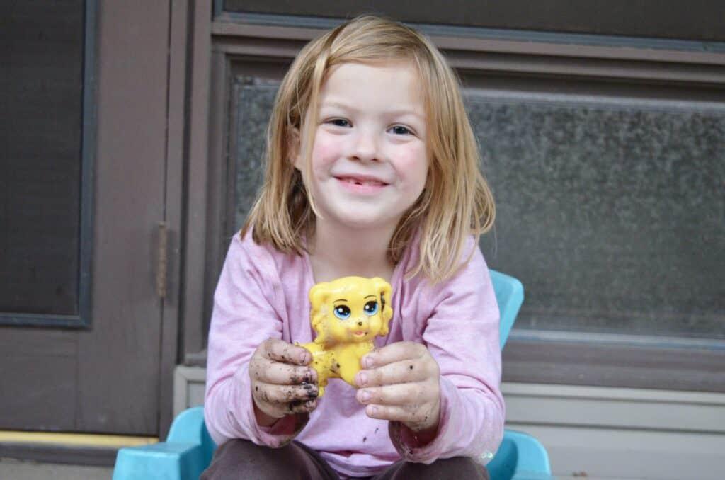preschool girl holding dog toy