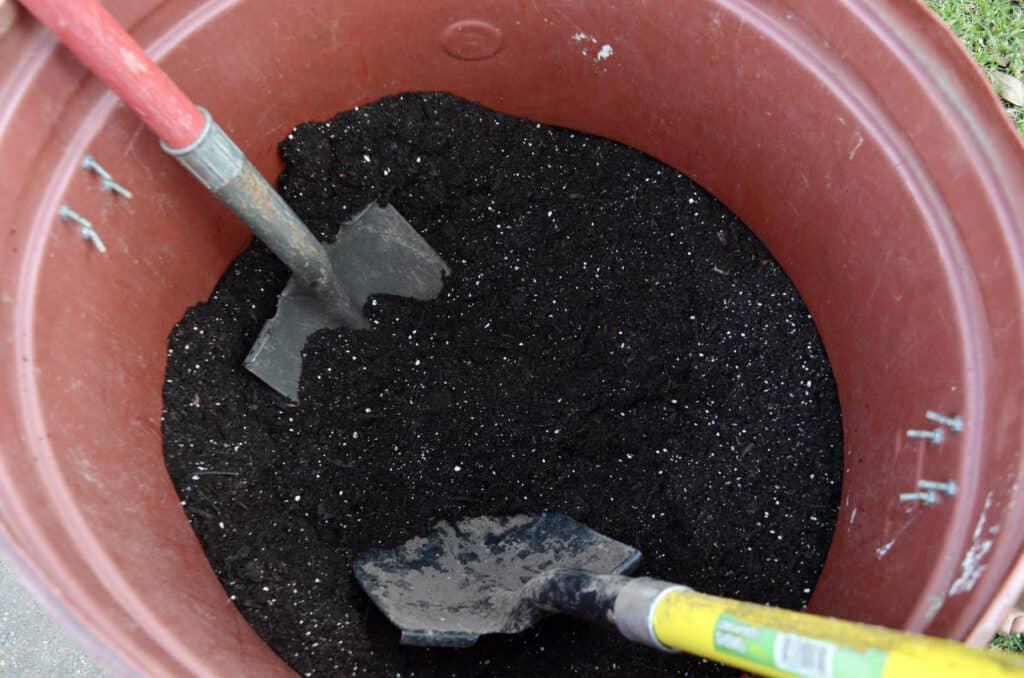 large pot of dirt and potting soil