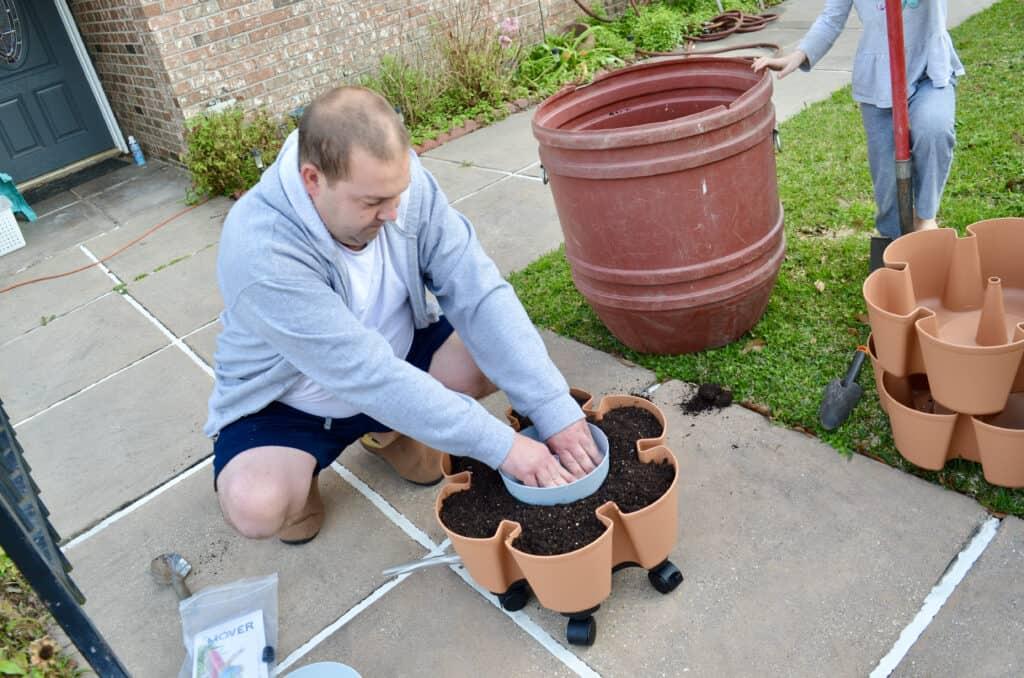 man putting together GreenStalk Vertical Garden