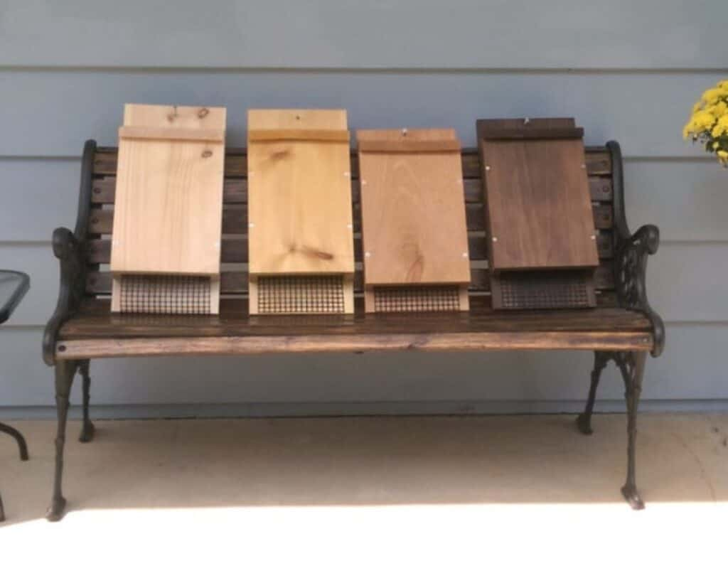 row of bat houses on a bench