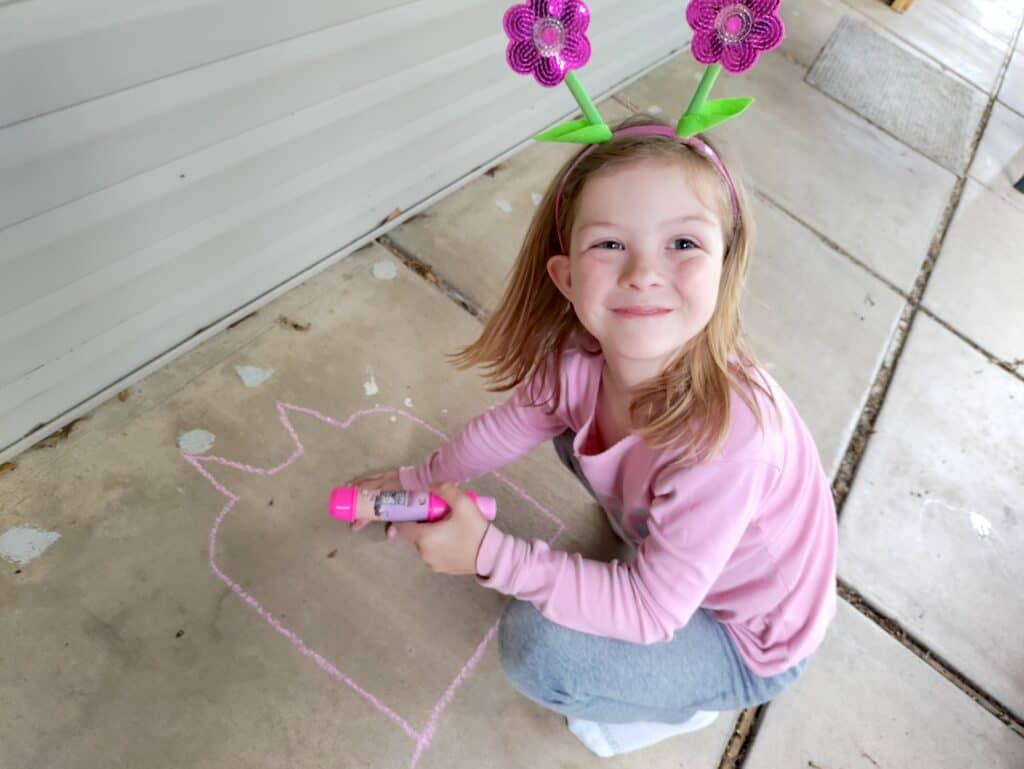 chalk art with young girl smiling