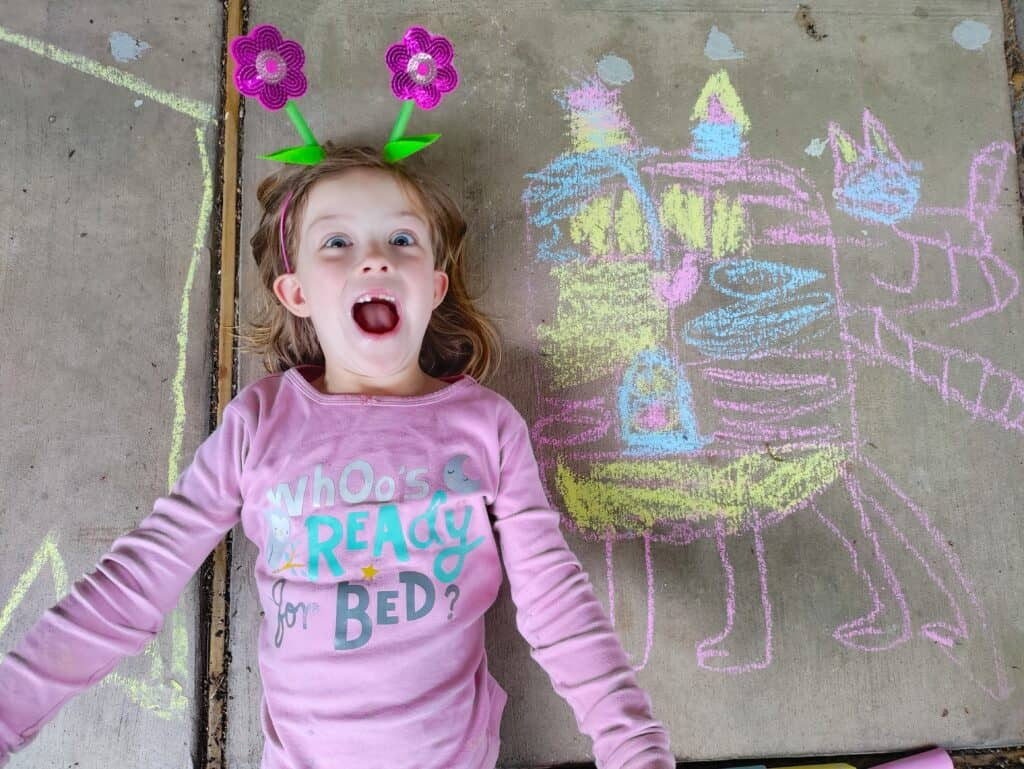 happy girl with her chalk art