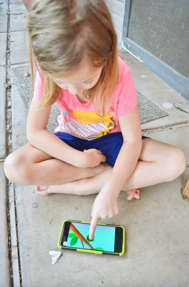 girl playing with Noggin learning app